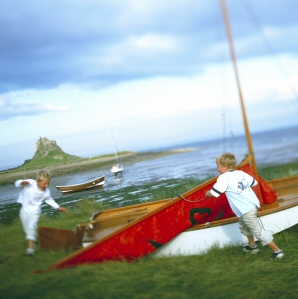 Boys playing in front of Lindisfarne Castle, Holy Island, Northumberland